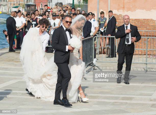 Italian model Alice Campello and her father Andrea arrive for her wedding to Spanish professional footballer Alvaro Morata at Redentore Church on...