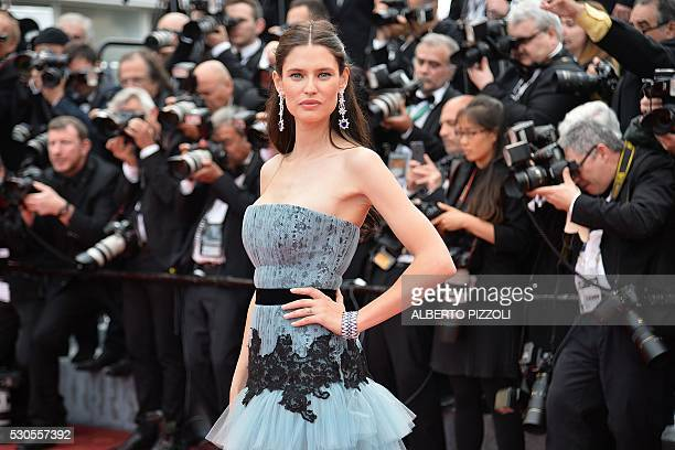 Italian model Bianca Balti poses as she arrives on May 11 2016 for the opening ceremony of the 69th Cannes Film Festival in Cannes southern France /...