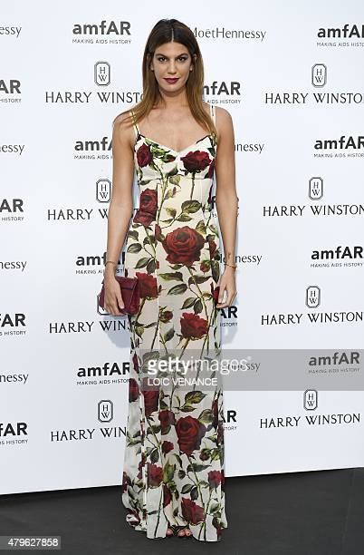 Italian model Bianca Brandolini D'Adda poses as she arrives for the amfAR dinner on the sidelines of the Paris fashion week in Paris on July 5 2015...