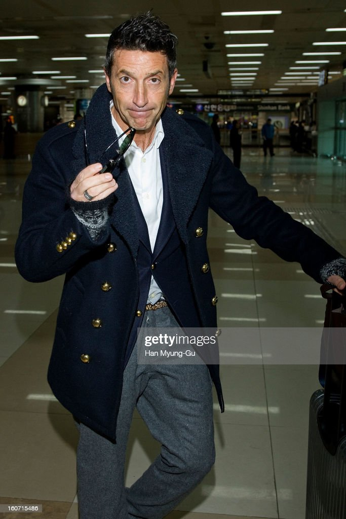 Italian model, Girolamo Panzetta is seen upon arrival a promotional event for the 'Cesare Paciotti' at Gimpo International Airport on February 4, 2013 in Seoul, South Korea.