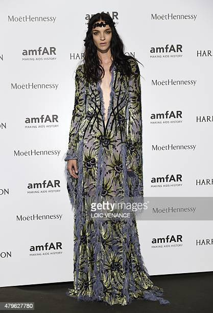 Italian model Mariacarla Boscono poses as she arrives for the amfAR dinner on the sidelines of the Paris fashion week in Paris on July 5 2015 AFP...