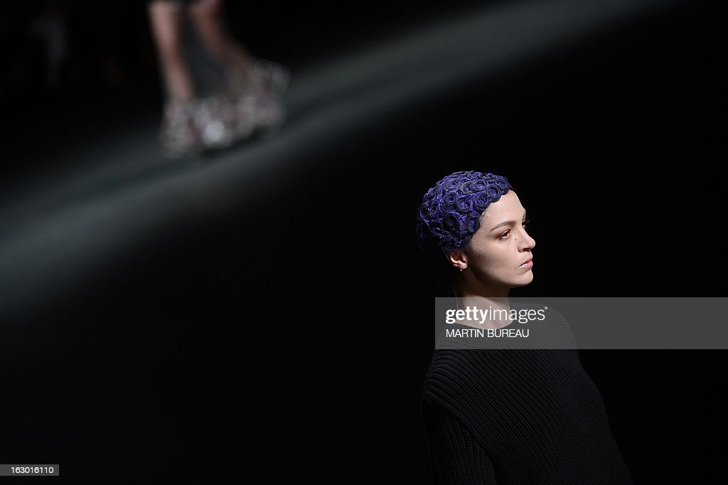 Italian model Mariacarla Boscono presents a creation for Givenchy during the Fall/Winter 2013-2014 ready-to-wear collection show, on March 3, 2013 in Paris.