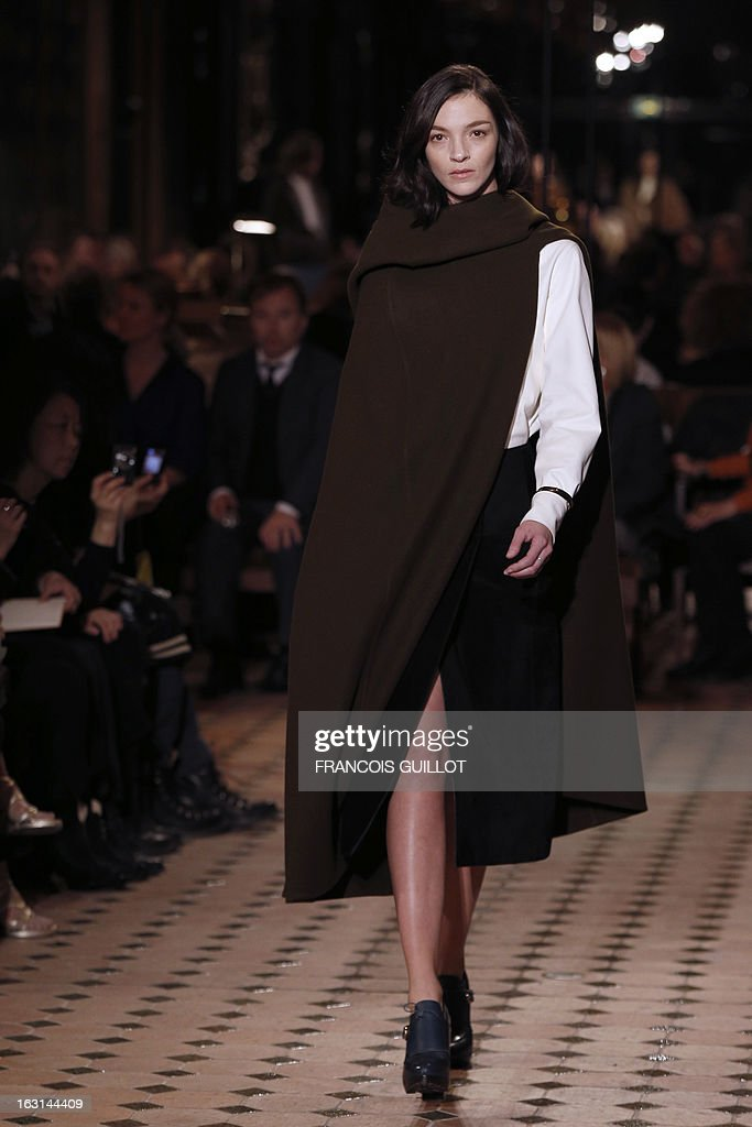 Italian model Mariacarla Boscono presents a creation for Hermes during the Fall/Winter 2013-2014 ready-to-wear collection show, on March 5, 2013 in Paris.