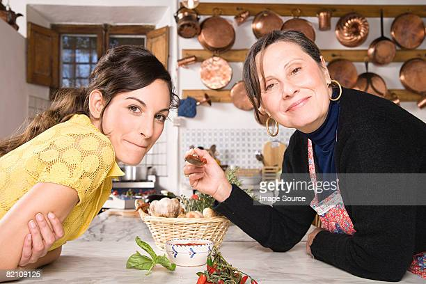 Italian mother and daughter in kitchen