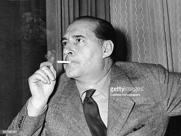 Italian motion picture director Roberto Rossellini smokes a cigarette London November 27 1959