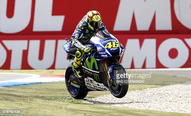 Italian MotoGP rider Valentino Rossi of the Movistar Yamaha MotoGP team celebrates after winning the Motorcycling Grand Prix TT Assen at the TT...