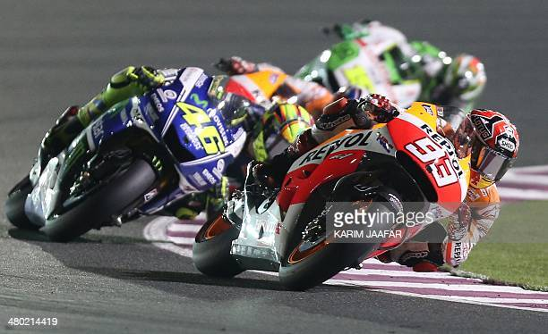 Italian MotoGP rider Valentino Rossi of the Movistar Yamaha MotoGP team and Repsol Honda Team rider and World champion Spanish Marc Marquez compete...