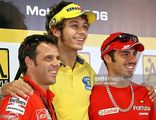 Italian MotoGP riders Loris Capirossi of Ducati Marlboro Team Valentino Rossi of Camel Yamaha Team and Marco Melandri of Fortuna Honda pose for the...
