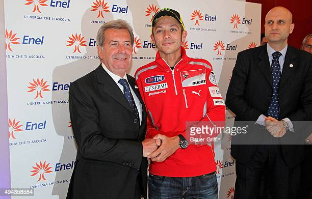 Italian Motogp world Champion Valentino Rossi and Enel president Fulvio Conti are seen opening new flagship store on May 10 2011 in Milan Italy