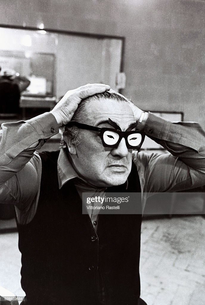 Italian movie director <a gi-track='captionPersonalityLinkClicked' href=/galleries/search?phrase=Federico+Fellini&family=editorial&specificpeople=243035 ng-click='$event.stopPropagation()'>Federico Fellini</a> wearing a pair of comic spectacles.