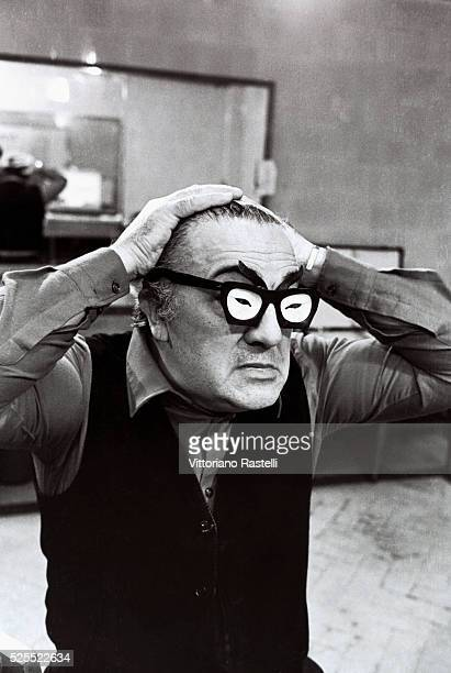 Italian movie director Federico Fellini wearing a pair of comic spectacles
