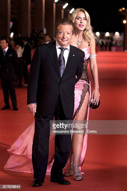 italian movie producer Vittorio Cecchi Gori and Italian showgirl Valeria Marini arrive at the opening ceremony of the 2008 Rome Film Festival