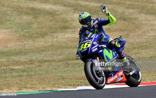 Italian Movistar Yamaha rider Valentino Rossi celebrates after the free practice session of the Moto GP Italian Grand Prix at Mugello racetrack on...