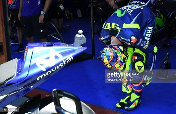 Italian Movistar Yamaha rider Valentino Rossi prepares himself for a Moto GP free practice session of the Italian Grand Prix at the Mugello track on...