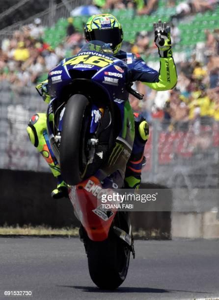 TOPSHOT Italian Movistar Yamaha rider Valentino Rossi waves during the Moto GP free practice session of the Italian Grand Prix at the Mugello track...
