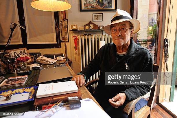 Italian musician and author Lucio Dalla poses at his home prior to the start of a charity auction taking place at the Coop Ambasciatori bookshop on...
