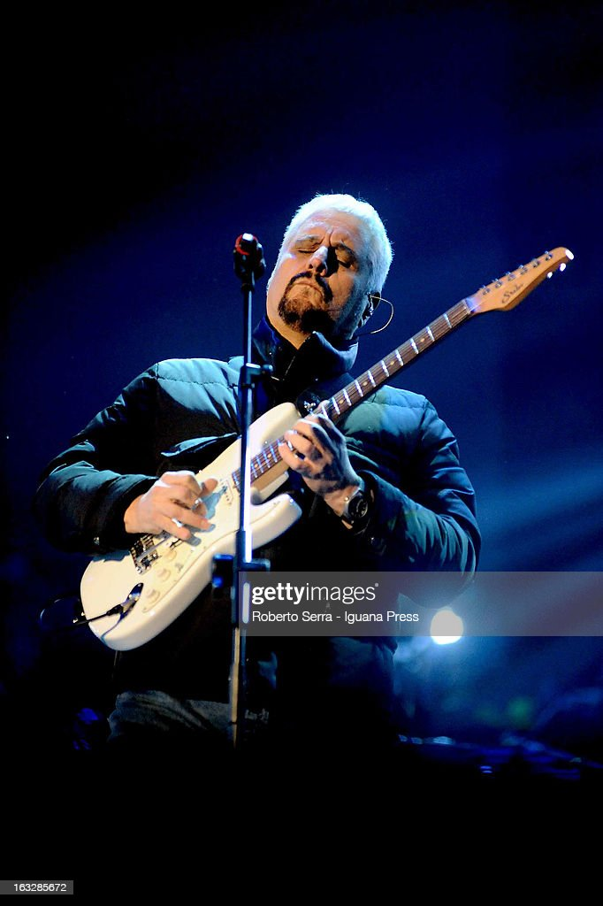 Italian musician and author <a gi-track='captionPersonalityLinkClicked' href=/galleries/search?phrase=Pino+Daniele&family=editorial&specificpeople=2639290 ng-click='$event.stopPropagation()'>Pino Daniele</a> performs the Lucio Dalla Tribute at Piazza Maggiore on March 4, 2013 in Bologna, Italy.