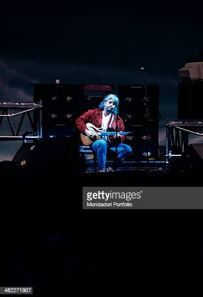 Italian musician and singersongwriter Pino Daniele playing guitar in concert Italy 1994