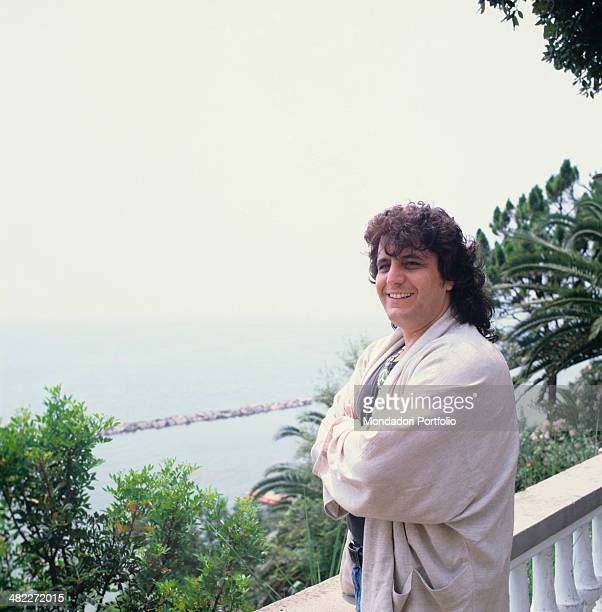 Italian musician and singersongwriter Pino Daniele smiling with folded arms 1987