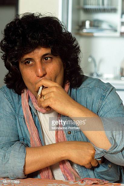 Italian musician and singersongwriter Pino Daniele smoking a cigarette 1982