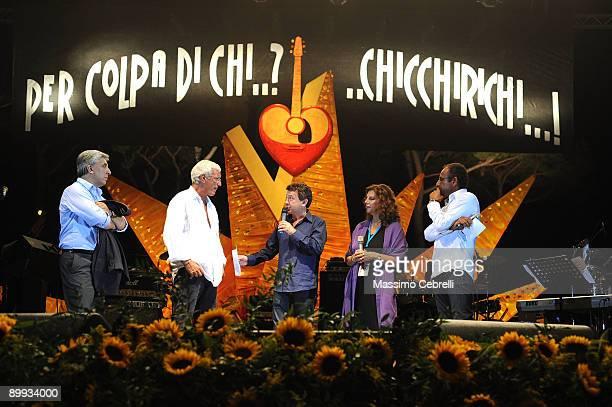 Italian national football team Coach Marcello Lippi and actres Stefania Sandrelli stand onstage at the Concerto per Viareggio a charity concert for...