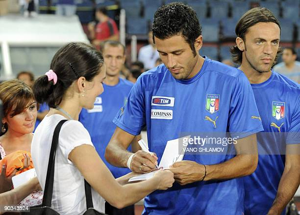 Italian national football team player Fabio Grosso signs an autograph during a training session in Tbilisi on September 4 2009 on the eve of the 2010...