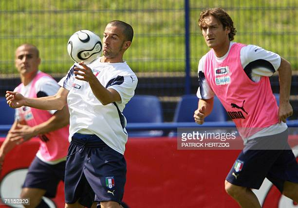 Italian national forward Alessandro Del Piero controls the ball in front of Francesco Totti during their first training session 08 June 2006 in...