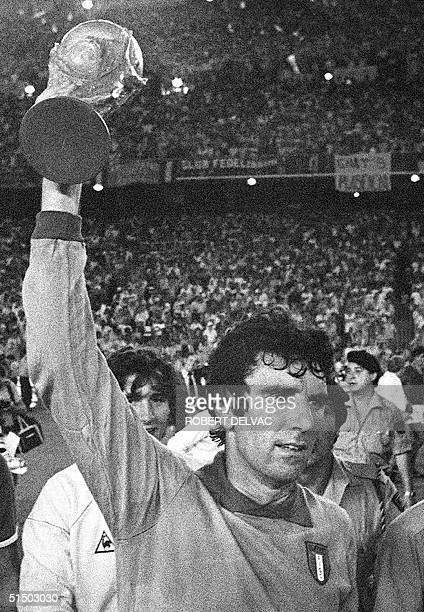 Italian national soccer team captain and goalkeeper Dino Zoff brandishes the FIFA World Cup trophy after Italy defeated West Germany 31 in the World...