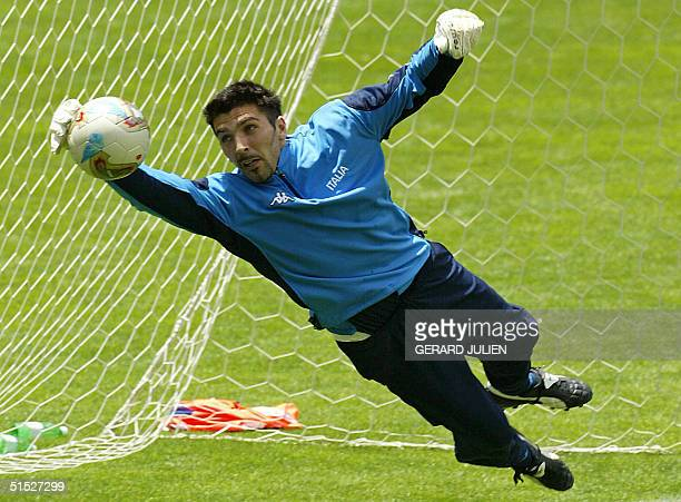 Italian national soccer team goalkeeper Gianluigi Buffon catches the ball during a training session at the Sendai Stadium 25 May 2002 Italy is...