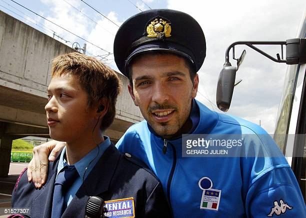 Italian national soccer team goalkeeper Gianluigi Buffon poses a with a security agent after a training session at the Sendai Stadium 25 May 2002...