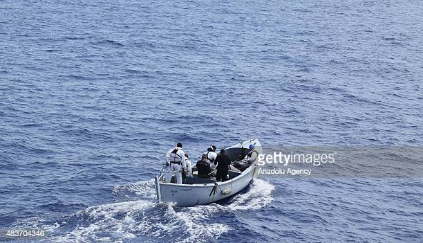 Italian Naval soldiers stage a rescue operation after a boat carries illegal immigrants sank in the Mediterranean offshore of the east of Tripoli...