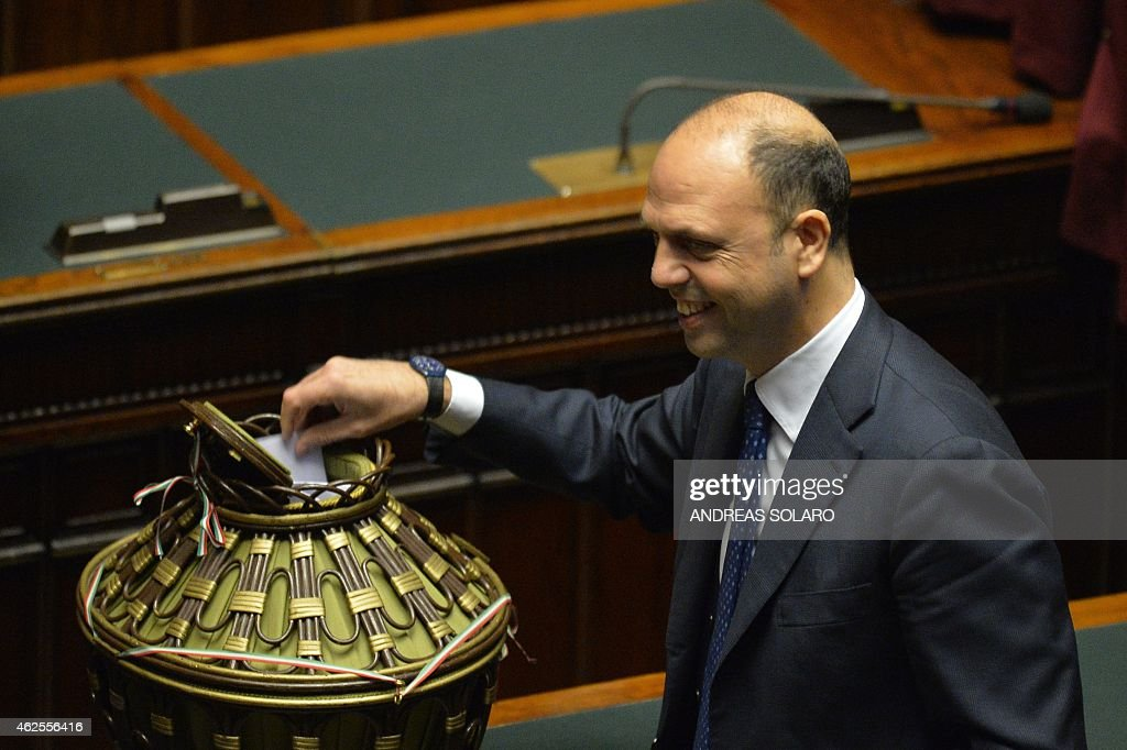Italian New Centre Right secretary and Interior Minister Angelino Alfano casts his ballot on January 31 2015 at the Italian Parliament in Rome during...