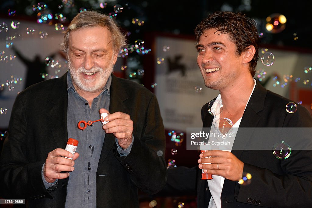 Italian NGO Emergency <a gi-track='captionPersonalityLinkClicked' href=/galleries/search?phrase=Gino+Strada&family=editorial&specificpeople=4203022 ng-click='$event.stopPropagation()'>Gino Strada</a> and Italian actor <a gi-track='captionPersonalityLinkClicked' href=/galleries/search?phrase=Riccardo+Scamarcio&family=editorial&specificpeople=816804 ng-click='$event.stopPropagation()'>Riccardo Scamarcio</a> attend the 'Tracks' premiere during the 70th Venice International Film Festival at the Palazzo del Cinema on August 29, 2013 in Venice, Italy.