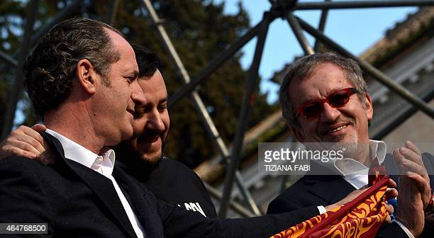 Italian Northern League party leader Matteo Salvini poses with Italian politician Luca Zaia and Italian Northern League Roberto Maroni during a rally...