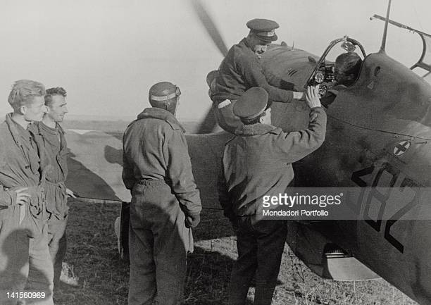 Italian officers and airmen greeting a pilot getting ready to take off to the Russian lines April 1943