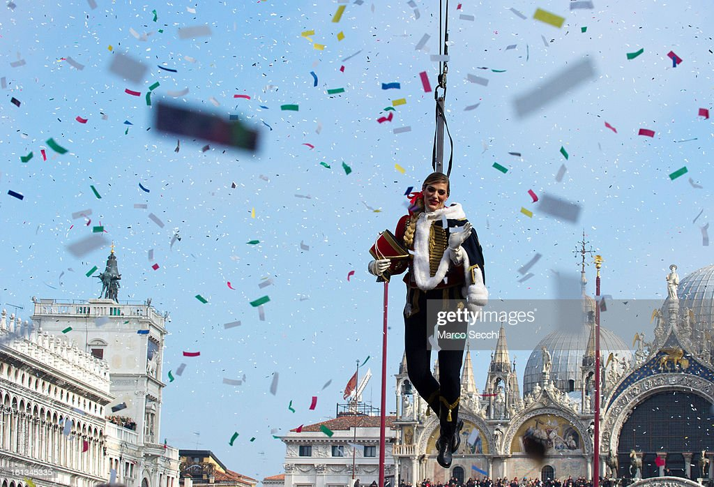Italian Olympic volleyball player Francesca Piccinini performs during the Volo dell'Aquila as she suspended from a wire from San Marco Tower to the...