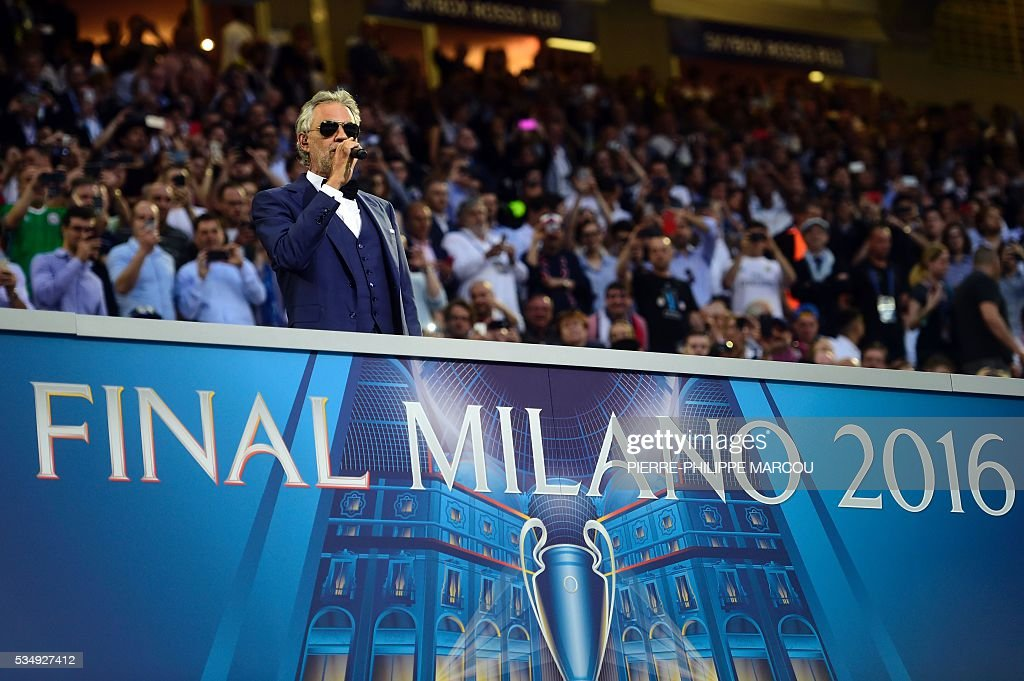 Italian opera singer Andrea Bocelli performs at the start of the UEFA Champions League final football match between Real Madrid and Atletico Madrid at San Siro Stadium in Milan, on May 28, 2016. / AFP / PIERRE