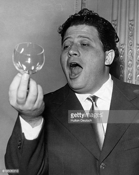Italian opera singer Luigi Infantino tries to break a wine glass by singing top 'C' at a rehearsal