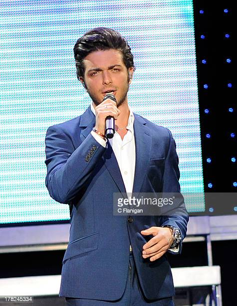 Italian operatic pop singer Gianluca Ginoble of Il Volo performs at Sleep Train Amphitheatre on August 27 2013 in Concord California