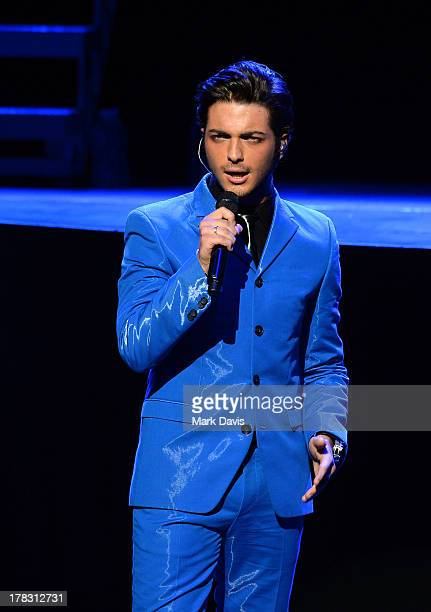 Italian operatic pop singer Gianluca Ginoble of Il Volo performs at Gibson Amphitheatre on August 28 2013 in Universal City California