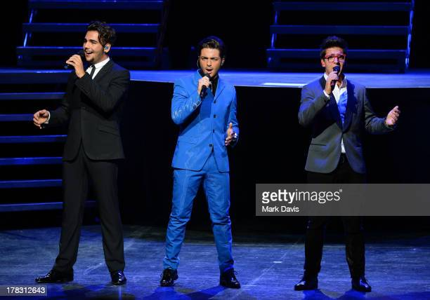Italian operatic pop singers Piero Barone Gianluca Ginoble and Ignazio Boschetto of Il Volo perform at Gibson Amphitheatre on August 28 2013 in...