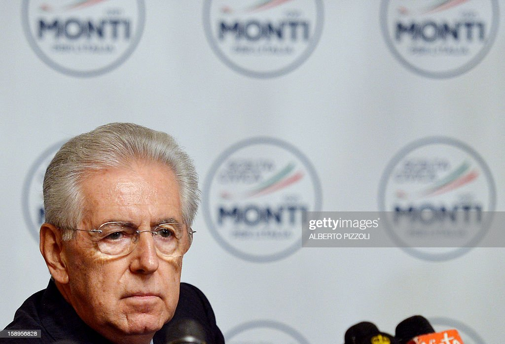 Italian outgoing Prime Minister Mario Monti looks on after unveiling the logo of his new party during a press conference in Rome on January 4, 2013. The coalition of centrist parties led by Monti is currently running in fourth place ahead of early elections in February, according to a poll published on to-day.
