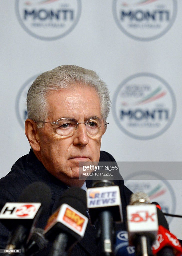 Italian outgoing Prime Minister Mario Monti looks on after unveiling the logo of his new party during a press conference in Rome on January 4, 2013. The coalition of centrist parties led by Monti is currently running in fourth place ahead of early elections in February, according to a poll published on to-day. AFP PHOTO / ALBERTO PIZZOLI