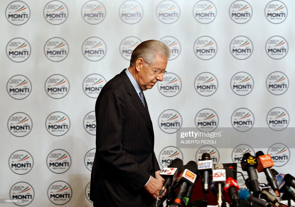 Italian outgoing Prime Minister Mario Monti stands up after unveiling the logo of his new party during a press conference in Rome on January 4, 2013. The coalition of centrist parties led by Monti is currently running in fourth place ahead of early elections in February, according to a poll published on to-day.