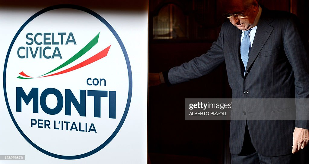 Italian outgoing Prime Minister Mario Monti unveils the logo of his new party during a press conference in Rome on January 4, 2013. The coalition of centrist parties led by Monti is currently running in fourth place ahead of early elections in February, according to a poll published on to-day.