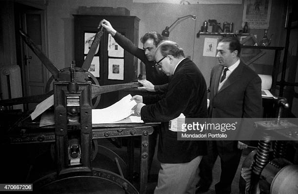 'Italian painter Aligi Sassu and editor Luigi De Tullio at work using a printing press Sassu has been a great exponent of Futurism and Primitivism in...