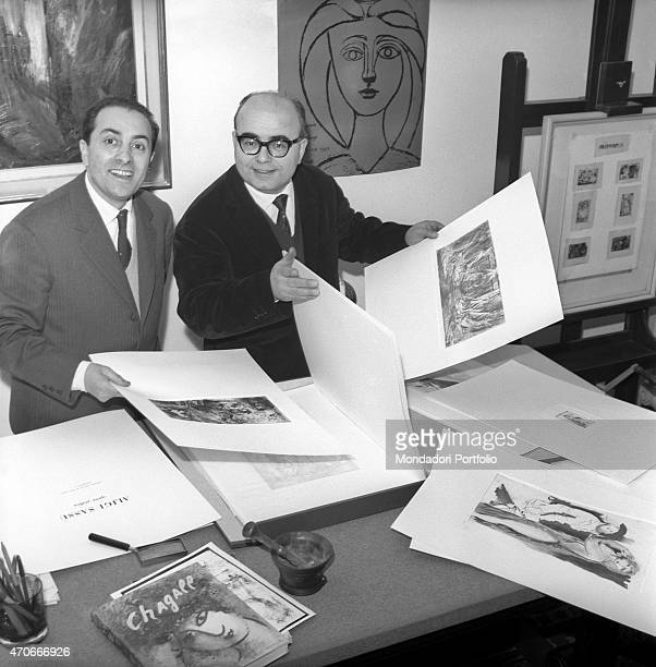 'Italian painter Aligi Sassu and editor Luigi De Tullio check some printing material they have printed using a press Sassu has been a great exponent...