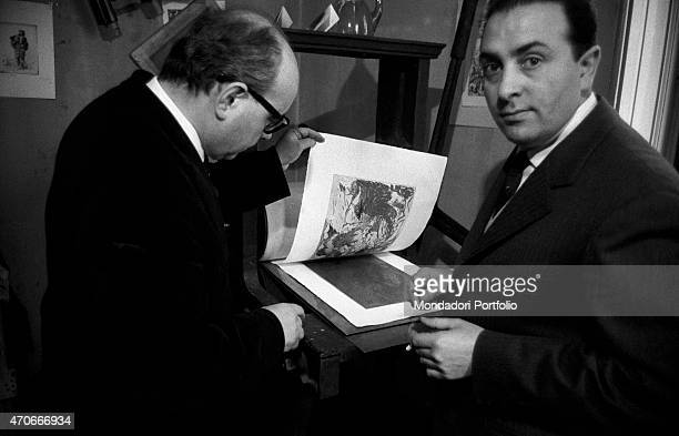 'Italian painter Aligi Sassu and editor Luigi De Tullio pose beside a printing press Sassu has been a great exponent of Futurism and Primitivism in...