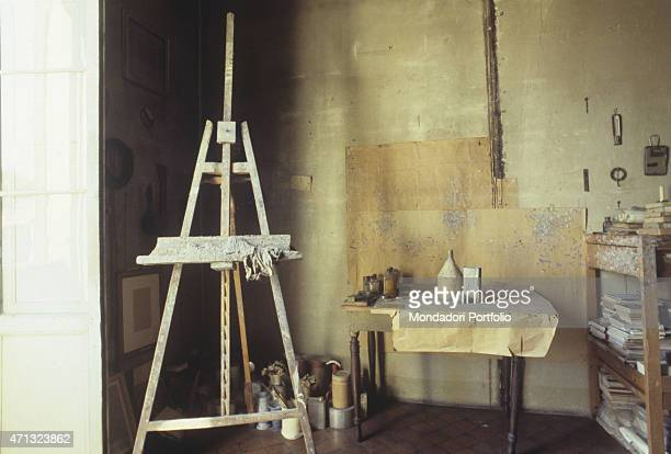 Italian painter Giorgio Morandi's atelier on via Fondazza 36 On the left the easel and on the table against the wall the bottles he used for still...
