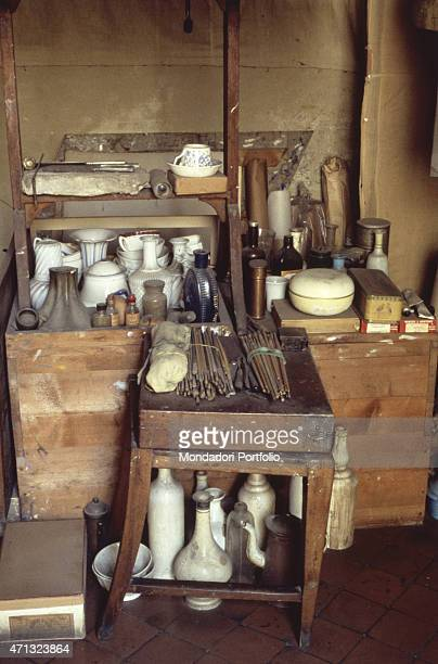 Italian painter Giorgio Morandi's tools at his atelier on via Fondazza 36 On a stool some brushes and the bottles he used for still life paintings...